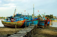 Free Fishing Boats Docked Near The Jetty Royalty Free Stock Image - 30676236