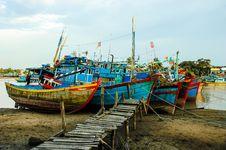Free Fishing Boats Docked Near The Jetty Royalty Free Stock Image - 30676236