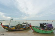Fishing Boats Anchored At The Shore-line Stock Photography
