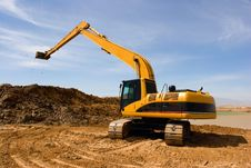 Free Orange Excavator At Construction Site Stock Image - 30679411
