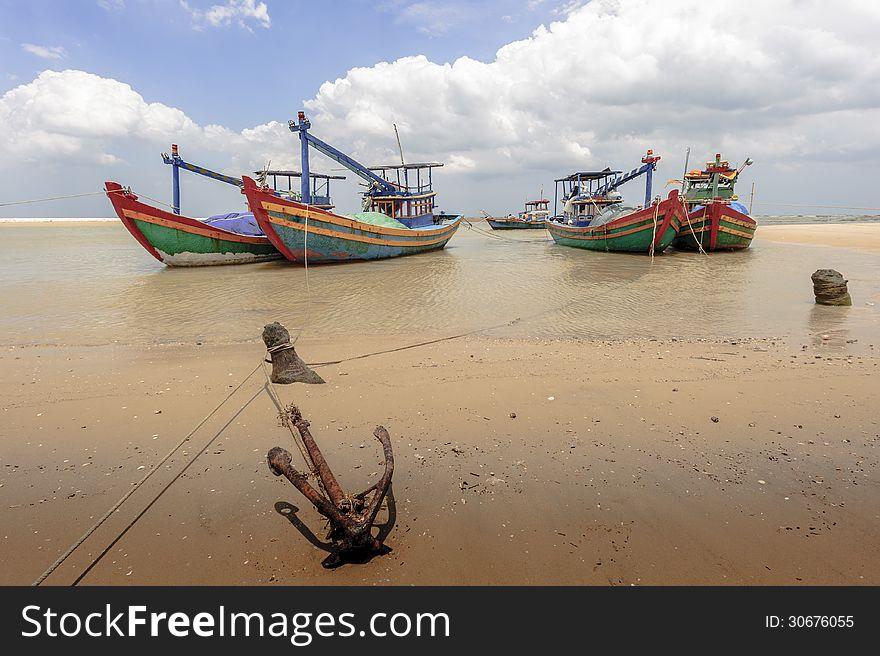 Fishing boats and  anchor at shore-line