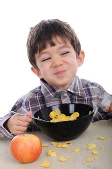 Free Boy Is Eating Corn Flakes Stock Photo - 30688980