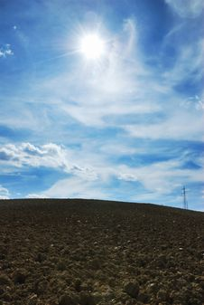 Free Sun Over Plowed Land Royalty Free Stock Photography - 3078767
