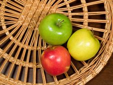 Apples On Wicker Plate Stock Photography