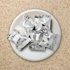 Free Foil Package On White Plate Royalty Free Stock Image - 30700336