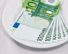Money On A White Plate Stock Image