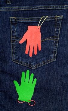 The Pocket Of Jeans And Two Paper Palms Stock Photography