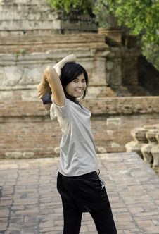 Asian Woman At Wat Maheyong Temple. Ayutthaya - Thailand Royalty Free Stock Photo