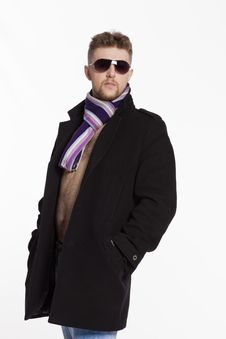 Portrait Of Handsome Stylish Blond Man In Sunglasses And A Coat Royalty Free Stock Image