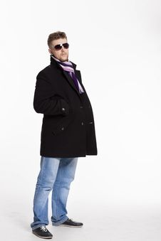 Portrait Of Handsome Stylish Blond Man In Sunglasses And A Coat Stock Photography