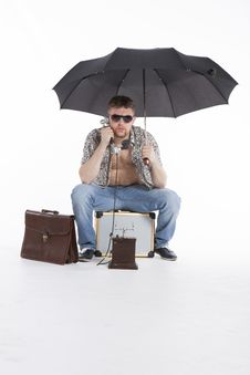 Free Young Athletic Businessman Under Umbrella Royalty Free Stock Photos - 30728598