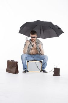 Free Young Athletic Businessman Under Umbrella Stock Images - 30728664
