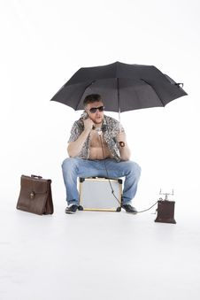Free Young Athletic Businessman Under Umbrella Stock Photos - 30728703
