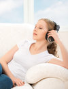 Free Woman In Headphones Enjoys Music While Lying On The Sofa At Home Royalty Free Stock Image - 30732786