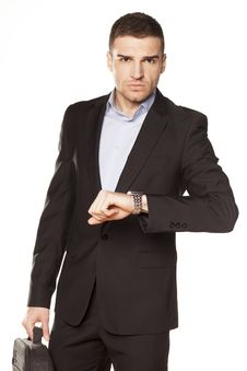 Free Businessman Looking At His Watch Royalty Free Stock Photos - 30730678