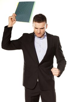 Free Angry Young Businessman With Folder Royalty Free Stock Photography - 30731107