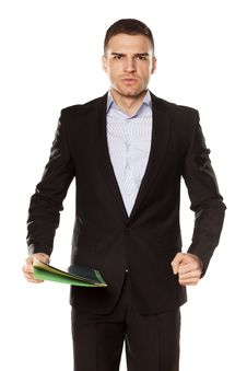 Free Angry Young Businessman With Folder Royalty Free Stock Photo - 30731145