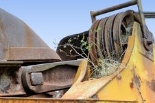 A Plant Growing On An Old Coal Excavator Stock Image