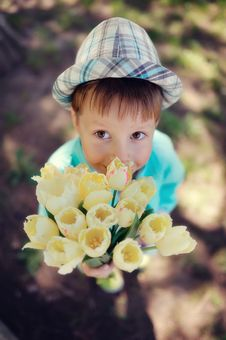 Child With Tulips Royalty Free Stock Photos
