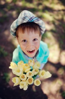 Child With Tulips Royalty Free Stock Photo