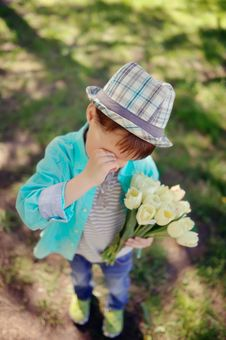 Child With Tulips Stock Photo