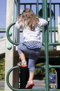 Free Girl Climbing Up A Ladder Royalty Free Stock Photography - 30756237