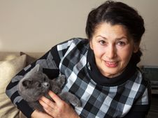 Pretty Woman With A Cat Stock Photography