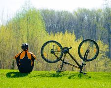 Free Cyclist Sitting On The Grass Near His Bike Royalty Free Stock Photos - 30775968
