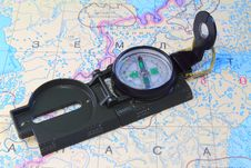 A Compass And A Map Of The North Of Russia Stock Photos