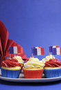 Free French Theme Red, White And Blue Mini Cupcake Cakes With Flags Of France - Vertical. Stock Images - 30788664