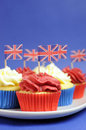 Free English Theme Red, White And Blue Cupcakes With Great Britain Union Jack Flags - Close Up Vertical. Stock Image - 30788751