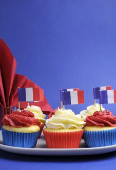 French Theme Red, White And Blue Mini Cupcake Cakes With Flags Of France - Vertical. Stock Images