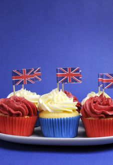 English Theme Red, White And Blue Cupcakes With Great Britain Union Jack Flags - Vertical With Copy Space. Stock Photo