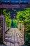Free Garden Lattice Walkway With Stone Pavers And Vine Flowers Throug Stock Photos - 30787873