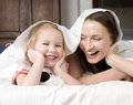 Free Portrait Of Happy Mother And Daughter In Bed Hugging And Smiling Stock Images - 30796244
