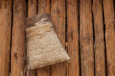 Free Bag From Birch Bark For Firewoods On The Wooden Wall Royalty Free Stock Photos - 30799808