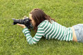 Free Girl Lying With Photo Camera Stock Photo - 3080180