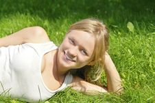 Free Smiling Girl Lying On Grass Stock Photo - 3083000