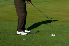 Free Golfer Aligning And Practicing Stock Photo - 3089910
