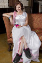 Free Young Bride On Couch Wearing Tennis Shoes Royalty Free Stock Image - 30809246
