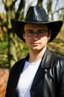 Free Young Attractive Man In A Black Leather Coat And Hat Royalty Free Stock Photo - 30804575