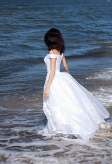 Young Girl In White Dress On The Seashore Stock Photo