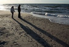 Two Silhouettes Of People On The Beach Royalty Free Stock Photo