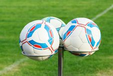Three Football Bals On Holders Royalty Free Stock Photography