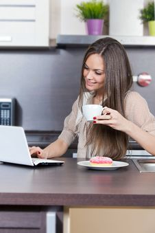 Young Woman At Home In The Kitchen Stock Photo