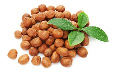 Free Heap Of Fresh Shelled Hazelnuts With Green Leaves. Royalty Free Stock Photo - 30813245