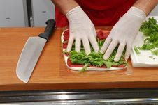 Hand Preparing A Sandwich Stock Photos