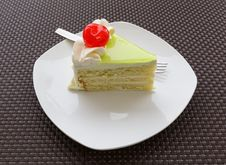 Vanilla Cake Slice And Fresh Cherry Royalty Free Stock Image