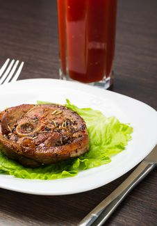 Glass Of Tomato Juice With Grilled Steak On White Plate