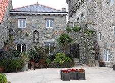 Free Stone House And Courtyard With Planters Royalty Free Stock Photography - 30844467
